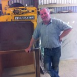Arthur beside his recently installed mini mill