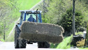 5. Tractor moving bale of hay