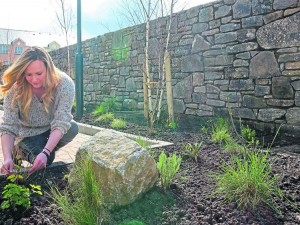 Garden Designer, Leonie Cornelius at work at the site.