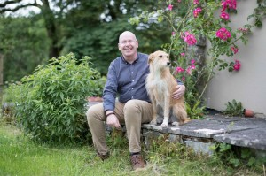 Brian O'Briain with his dog Charlie at home near Kilfenora, Co Clare. Brian was bitten by a tick in 2017 and was ill with Lyme disease for six months. Pic. Eamon Ward